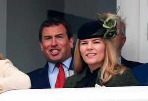 Autumn Phillips (right) during the Racing Post Arkle Challenge Trophy Novices' Chase alongside Peter Phillips (left) on day one of the Cheltenham Festival at Cheltenham Racecourse, Cheltenham