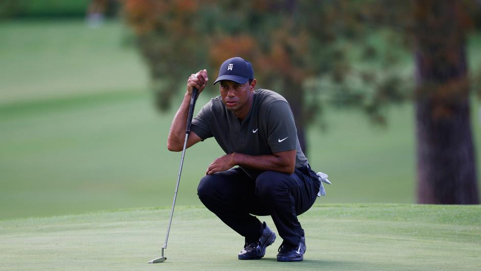 Tiger Woods lines up his putt on the 7th green during the first round of the 2020 US Masters
