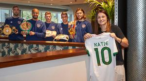 Katie Taylor meets the Ireland soccer squad at their London hotel ahead of Thursday's friendly with England at Wembley Stadium and Taylor's world title defence against Miriam Gutierrez at Wembley Arena on Saturday. Photo: Mark Robinson/Matchroom Boxing