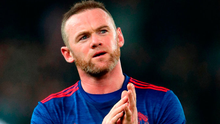 Manchester United's Wayne Rooney applauds the fans after his record-breaking leveller. Photo: Nick Potts/PA