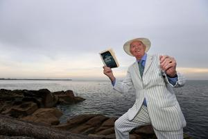 Bloomsday 2020. Peter Caviston with his copy of Ulysses at the Forty foot in Sandycove.  Picture; Gerry Mooney