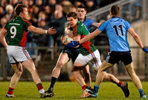 Lee Keegan, Mayo, supported by team-mate Donal Vaughan, 9, in action against Diarmuid Connolly and Dean Rock,11, Dublin