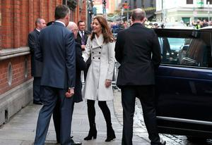 The Duchess of Cambridge in a cream Reiss coat for her visit to Jigsaw. Photo: AFP via Getty Images