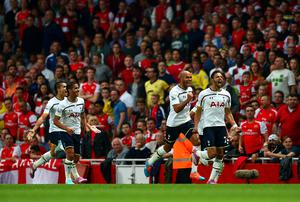 Nacer Chadli celebrates with team-mates after scoring the opening goal. Paul Gilham/Getty Images
