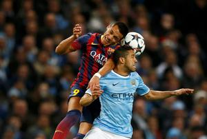 Manchester City's Gael Clichy (R) is challenged by Barcelona's Alexis Sanchez
