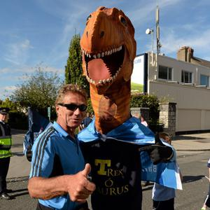 22 September 2013; Senator Eamonn Coghlan with T-Rex Ó Saurus arrive ahead of the GAA Football All-Ireland Championship Finals, Croke Park, Dublin. Picture credit: Stephen McCarthy / SPORTSFILE