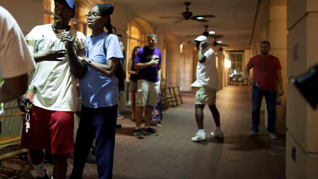 People concerned about relatives seek information from police nearby the scene of a shooting at the Emanuel AME Church in Charleston, South Carolina, June 17, 2015. A gunman opened fire on Wednesday evening at the historic African-American church in downtown Charleston. REUTERS/Randall Hill