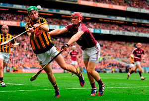 Kilkenny's Joey Holden clears the danger under pressure from Galway's Jonathan Glynn