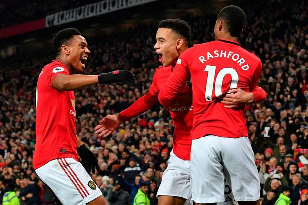 Three kings: Manchester United's goalscorers against Newcastle yesterday Anthony Martial, Mason Greenwood and Marcus Rashford embrace after Greenwood scored the hosts' second goal at Old Trafford. Photo: Paul Ellis/AFP via Getty Images