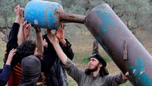 Rebel fighters from Suqour al-Sham Brigade prepare a locally made shell before launching it towards forces loyal to Syria's president Bashar Al-Assad in Idlib countryside. Reuters