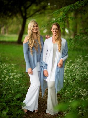 Light blue top with cut-out detail on shoulders, €68; widelegged yoga trousers, €65; white cardigan, €68; light grey, long, floor-length dress, €65; scarf, €18