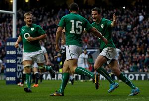 Ireland's Rob Kearney (centre) celebrates scoring  a try with team mates Jonathan Sexton (right) and  Chris Henry (left)