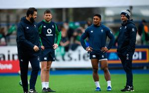 Head coach Andy Farrell, left, Ross Byrne, Bundee Aki, and Assistant coach Mike Catt