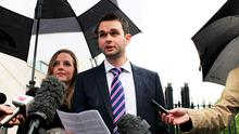 Daniel and Amy McArthur of Ashers Baking Company, outside Belfast County Court where he reads a statement to the media following a ruling that the bakery discriminated against a gay man when they refused to make a cake carrying a slogan that promoted same-sex marriage. Photo: Stephen Kilkenny/PA Wire