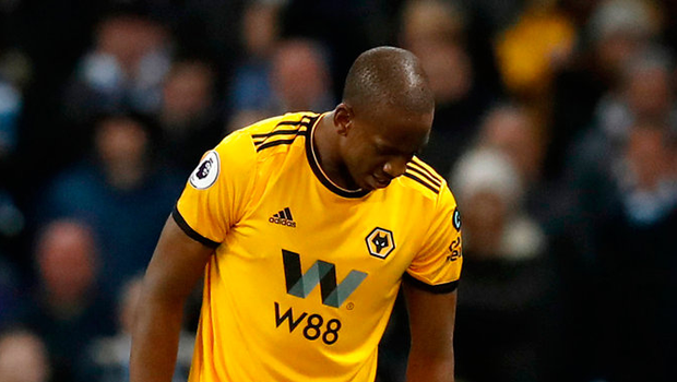 Willy Boly stands over Manchester City's Bernardo Silva just before the Wolves man was sent off during the first half. Photo: PA