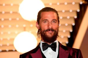 "US actor Matthew McConaughey smiles before leaving the Festival palace after the screening of the film ""The Sea of Trees"" at the 68th Cannes Film Festival"