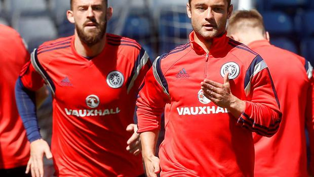 Scotland's Shaun Maloney (right) and Steven Fletcher (left) during a training session today