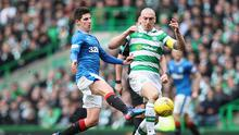 Emerson Hyndman of Rangers (L) and Scott Brown of Celtic (R) battle for possession during the Ladbrokes Scottish Premiership match between Celtic and Rangers at Celtic Park.  (Photo by Ian MacNicol/Getty Images)