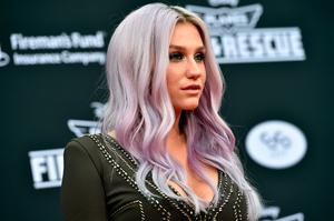 "Singer Kesha attends the premiere of Disney's ""Planes: Fire & Rescue"" at the El Capitan Theatre on July 15, 2014 in Hollywood, California.  (Photo by Kevin Winter/Getty Images)"