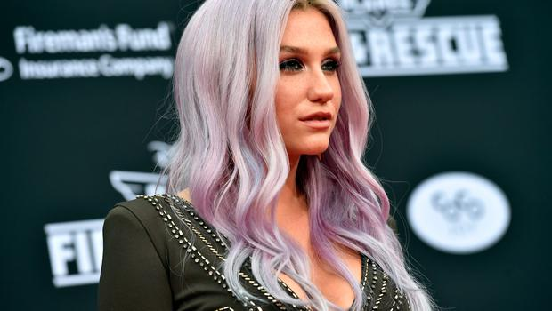 """Singer Kesha attends the premiere of Disney's """"Planes: Fire & Rescue"""" at the El Capitan Theatre on July 15, 2014 in Hollywood, California.  (Photo by Kevin Winter/Getty Images)"""