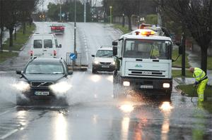 Clearing the flooding at Avondale Road, Dun Laoghaire. Photo: Ray Cullen