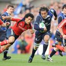 Munster's Doug Howlett and Leinster's Isa Nacewa in action in the Heineken Cup Semi-Final in Croke Park, May 2009
