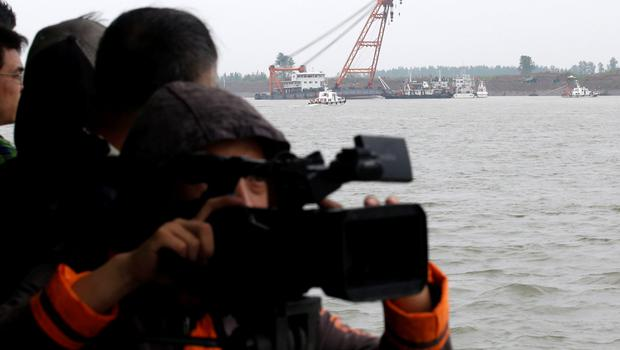A television crew films during a media trip to the site of the sinking of a cruise ship, organized by the Chinese government, in the Jianli section of Yangtze River, Hubei province, China, June 3, 2015. Picture taken June 3, 2015. REUTERS/Kim Kyung-Hoon