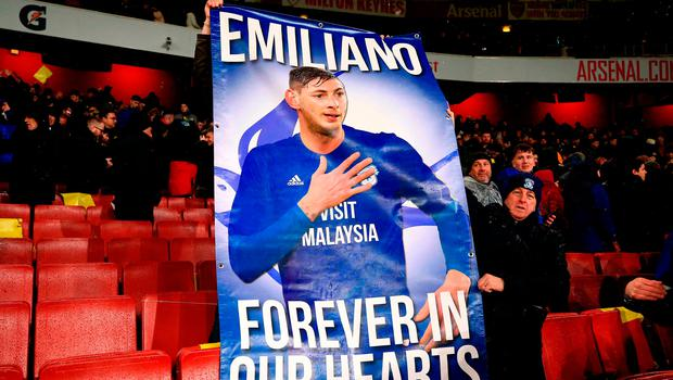Cardiff City fans in the stands with a banner reading 'Emiliano Forever in our hearts'. Photo: Nick Potts/PA