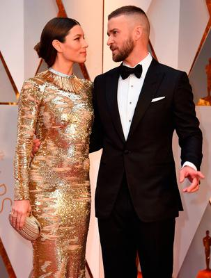 "Nominees for Best Music (Original Song) ""Can't Stop The Feeling"" from Trolls Justin Timberlake and his wife US actress Jessica Biel arrive on the red carpet for the 89th Oscars on February 26, 2017 in Hollywood, California.  / AFP PHOTO / VALERIE MACONVALERIE MACON/AFP/Getty Images"
