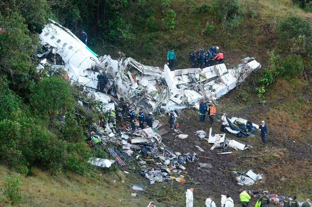 Rescue workers search for survivors at he wreckage of a chartered airplane that crashed in La Union, a mountainous area outside Medellin, Colombia, Tuesday , Nov. 29, 2016. (AP Photo/Luis Benavides)