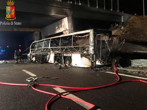 A charred bus, which was carrying Hungarian students, is seen on a side of a highway, near Verona, northern Italy, January 21, 2017. Italian Police/Handout via REUTERS