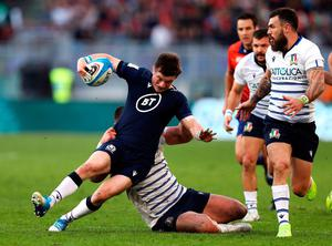 Scotland's George Horne is tackled by Italy's Giosue Zilocchi. Photo: Andrew Matthews/PA Wire