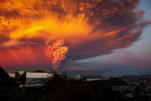 Smoke and ash rise from the Calbuco volcano as seen from the city of Puerto Montt REUTERS/Sergio Candia