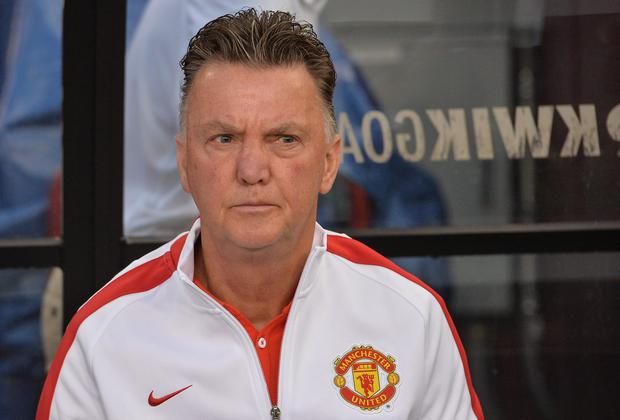 Manchester United coach Louis van Gaal believes playing Liverpool in the final 'is good for english football.' AFP PHOTO/Nicholas KAMM