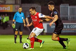 St Patrick's Athletic's Christy Fagan holds off Roberto Lopes of Bohemians in the FAI Ford Cup quarter-final at Richmond Park. Photo: Pat Murphy / SPORTSFILE