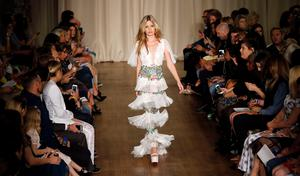 Model Georgia May Jagger presents a creation from the Marchesa Spring/Summer 2015 collection during London Fashion Week September 13, 2014. REUTERS/Suzanne Plunkett (BRITAIN - Tags: FASHION)