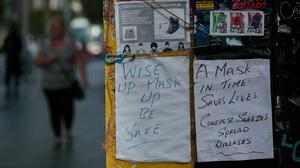 Wear a  face mask signs on O'Connell street during the Covid 19 Coronavirus pandemic in  Dublin's city centre Photo:Gareth Chaney/Collins