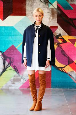 Teo wears a Navy Cape, €35; Cream Ruffle Dress, €28.00; Tan over the Knee Boots, €28