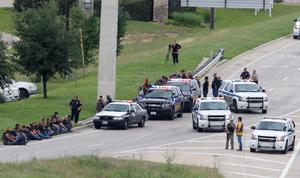 "Authorities block an access road as an investigation continues near a Twin Peaks restaurant Sunday, May 17, 2015, in Waco, Texas. Waco Police Sgt. W. Patrick Swanton told KWTX-TV there were ""multiple victims"" after gunfire erupted between rival biker gangs at the restaurant. (Rod Aydelotte/Waco Tribune-Herald via AP)"
