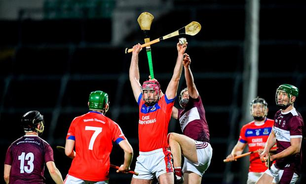James Regan of St Thomas' gathers possession ahead of James Devaney of Borris-Ileigh. Photo: Piaras Ó Mídheach/Sportsfile