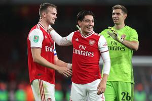 Arsenal's Rob Holding and Hector Bellerin embrace during their League Cup victory over Nottingham Forest last week. Photo: Charlotte Wilson/Offside via Getty Images
