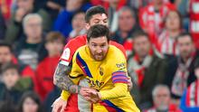 Lionel Messi attempts to get away from Ander Capa during Barcelona's 1-0 defeat in the Copa del Rey quarter-final against Athletic Bilbao. Photo: Ander Gillenea