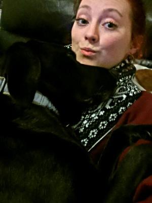 Clare Cullen takes a selfie with her black Labrador cross, Lucy.