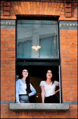Fans at a nearby shop window listen to Picture This performing on the balcony of The Westbury Hotel off Grafton Street as they announce their new tour and album. Pic Steve Humphreys 17th October 2018