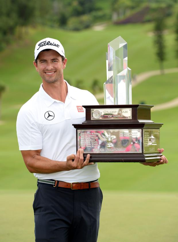 Adam Scott of Australia with the winners trophy after the final round of the PGA Grand Slam of Golf at Port Royal Golf Course on October 16, 2013 in Southampton, Bermuda