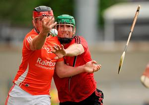 Artie McGuinness loses his hurley in action against Fintan Conway, Down