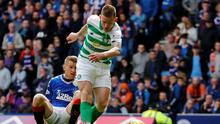 Celtic's Jonny Hayes scores in the Old Firm derby. Photo: Russell Cheyne/Reuters
