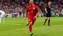 Jack Wilshere of England celebrates scoring their second goal against Slovenia