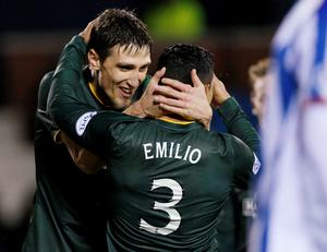 Celtic's Emilio Izaguirre (R) is congratulated on his goal against Kilmarnock by teammate Stefan Scepovic during their Scottish Premier League soccer match at Rugby Park in Kilmarnock