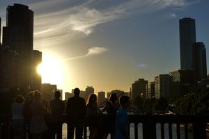 Crowds watch the sun go down for one last time this year before New Years Eve fireworks on December 31, 2013 in Melbourne, Australia.  (Photo by Vince Caligiuri/Getty Images)